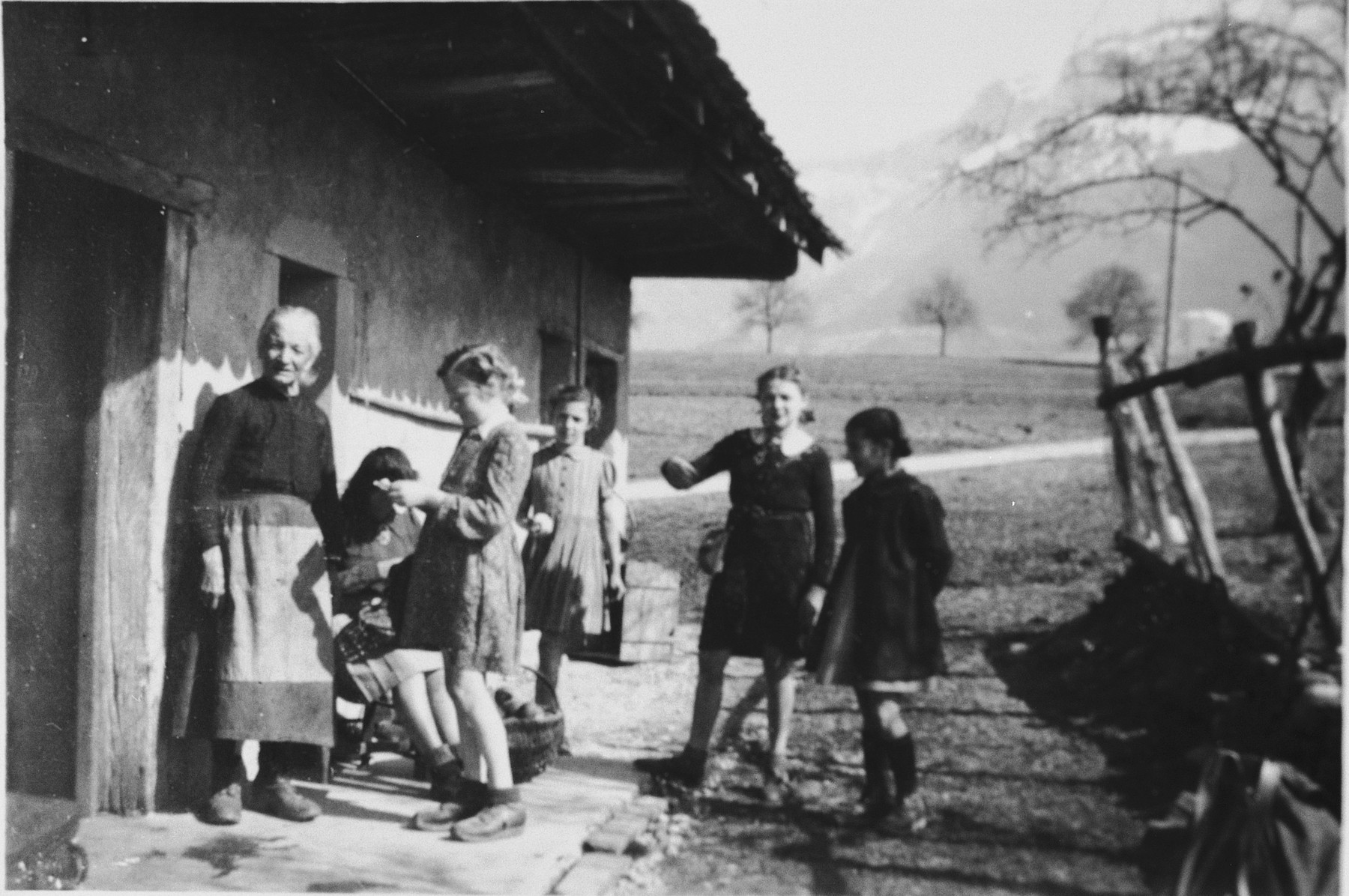 Young girls gather eggs in the Pringy children's home, operated by the Swiss Red Cross.