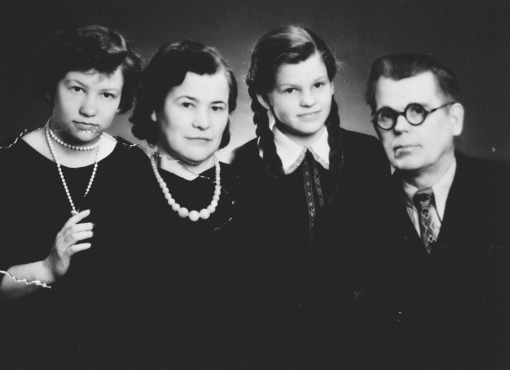 Postwar photograph of the family of Lithuanian rescuers, Vytautas and Elia Rinkevicius.