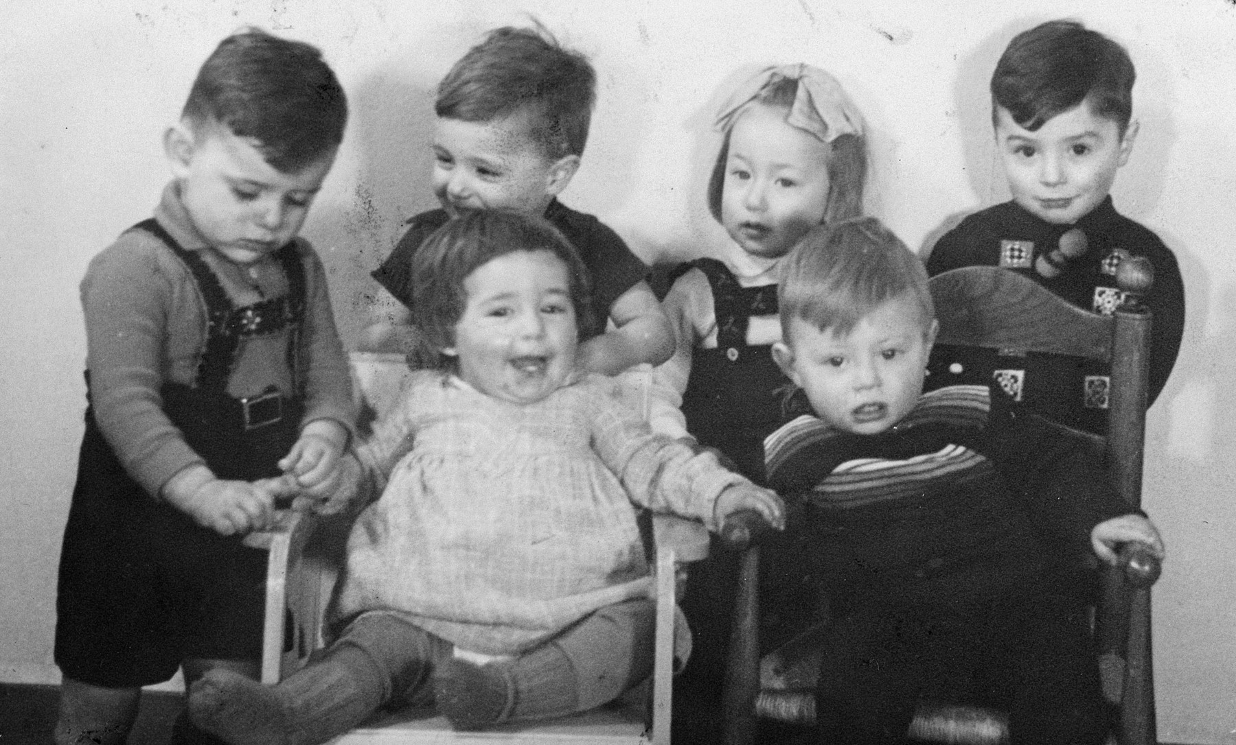 Young Dutch-Jewish children brought from the creche to a children's home by the Dutch underground.  Pictured on the top right is Jaap.