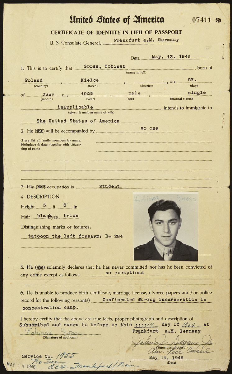 Certificate of identity in lieu of passport issued to Tobiasz Gross prior to his immigration to the United States.  The paper lists his identifying mark as a tattoo on his left forearm, B-284, and states that he was unable to produce other document because it was confiscated during his incarceration in concentration camp.
