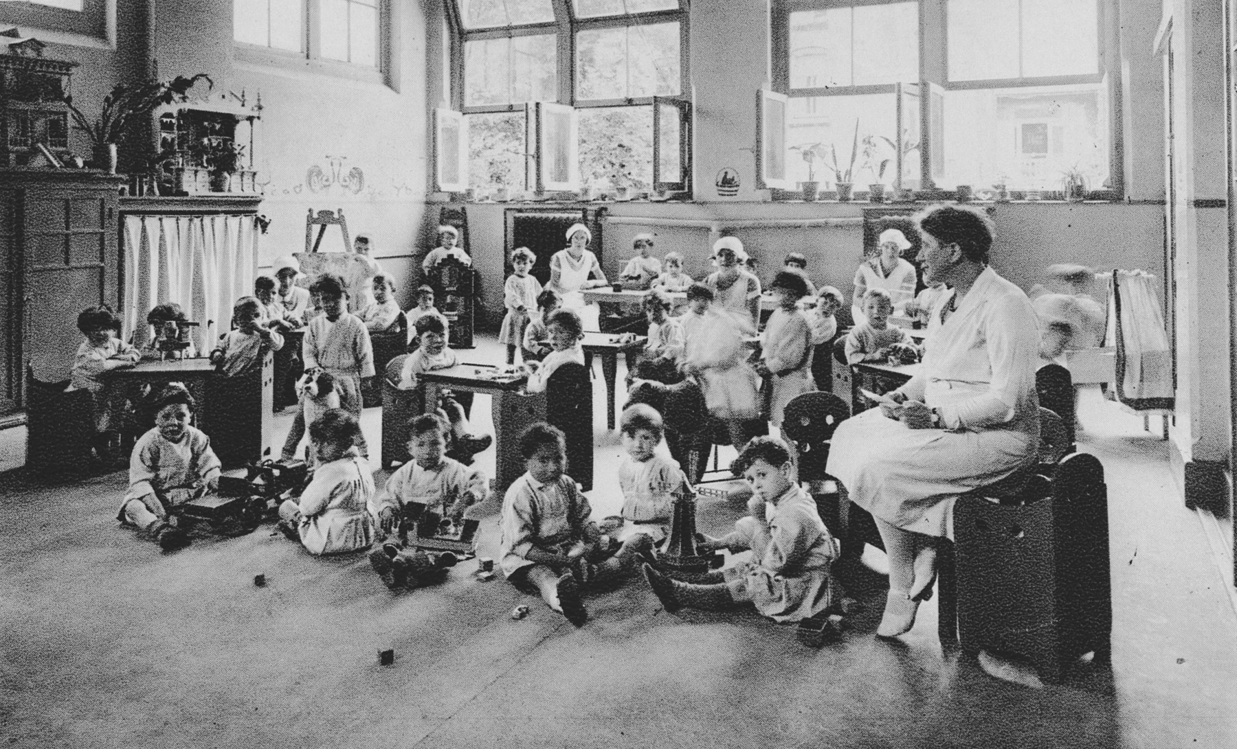 Young Dutch-Jewish children brought from the creche to a children's home by the Dutch underground play in a nursery class.  Pictured on the left is Henriette Pimentel.