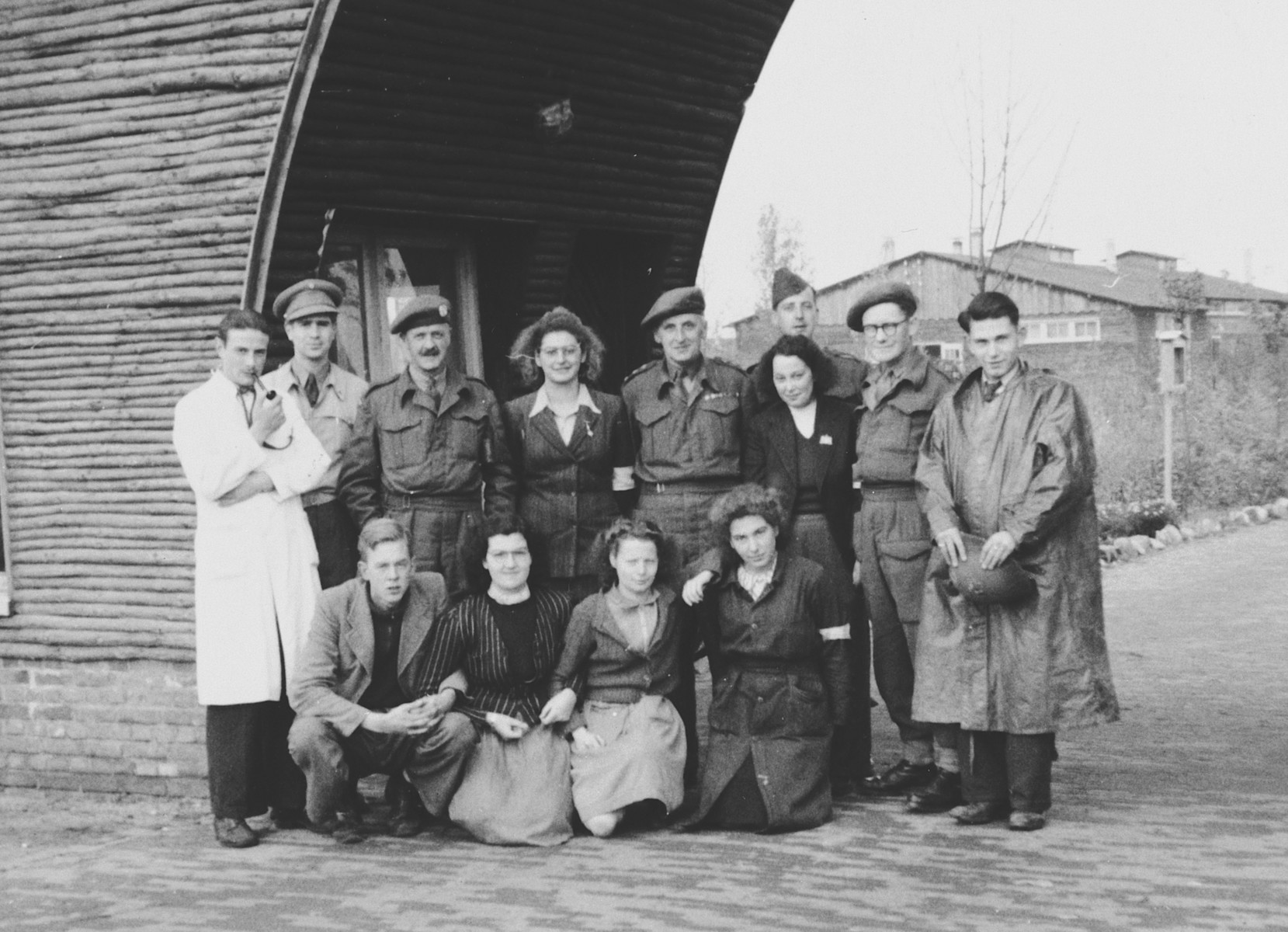Group portrait of Red Cross volunteers and British troops near Eindhoven where they were helping refugees escaping from the German army and the front line.  Among those pictured is Hilde Jacobstahl (second row, fourth from left).