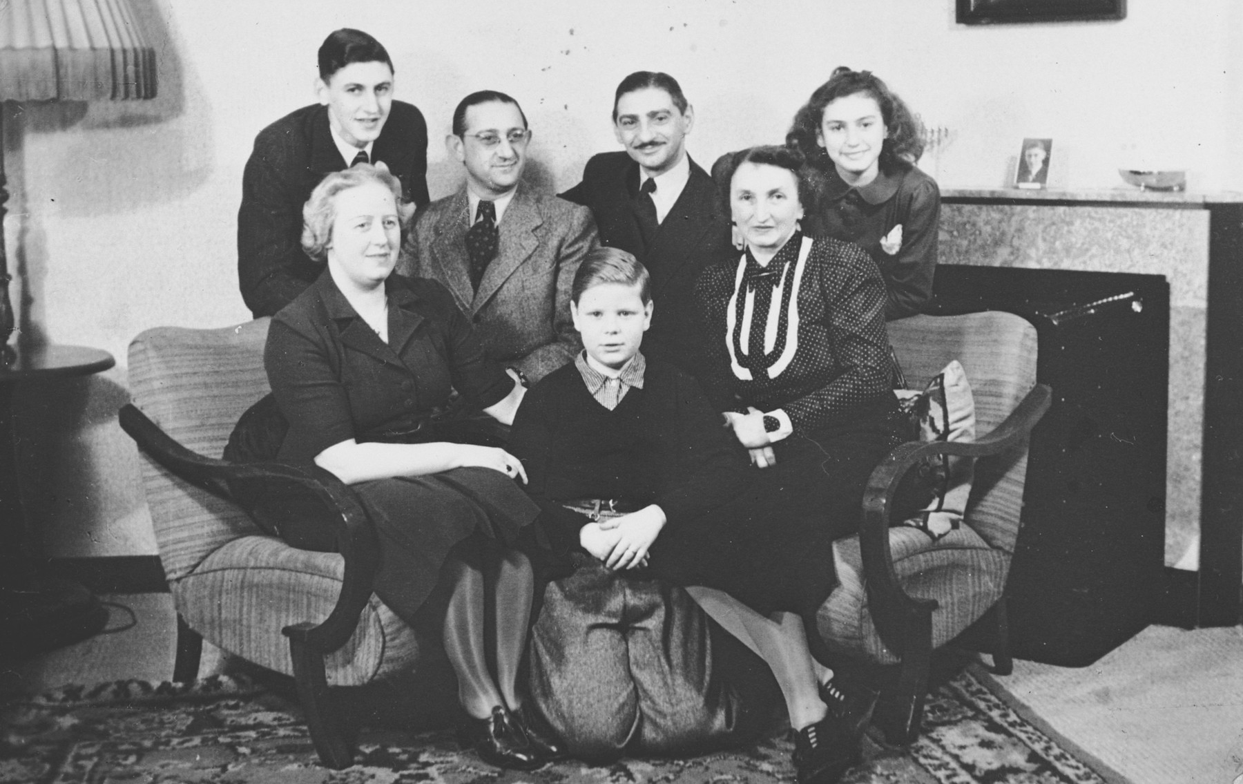 A German-Jewish family stops to visit relatives in Amsterdam on their way to Chile.  Pictured are the families of Walter and Hans Jacobsthal.