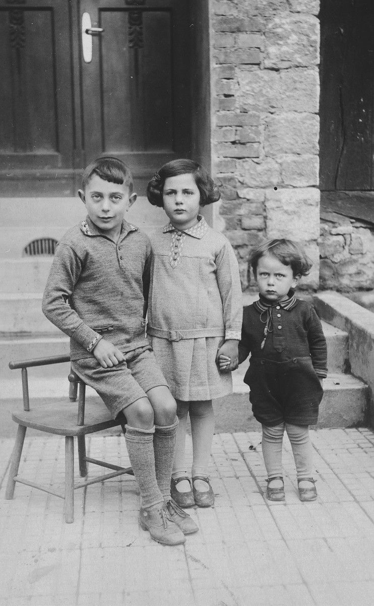 Three German-Jewish siblings pose outside their home in Rimbeck, Germany.  Pictured are Werner, Inge, and Ludwig Fischel.