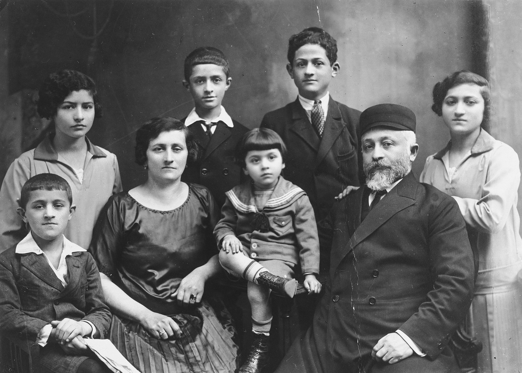Group portrait of a Polish Jewish family on the occasion of a golden wedding anniversary of Fajga and Noech Bursztajn.  Pictured front row, left to right are Chaim, Perla Bursztajn Jakubowicz, Alter and Josek Jakubowicz.  Second row: Bina, Mojzesz, Ajzyk and Sura.  Josek, Ajzyk and Chaim died in the Lodz ghetto between May and November 1942.  The others probably perished in Chelmno or Auschwitz.