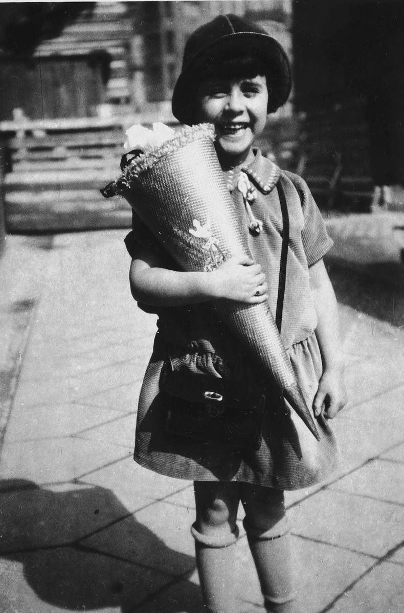 Irene Spicker holds a cone of goodies on her first day of school.