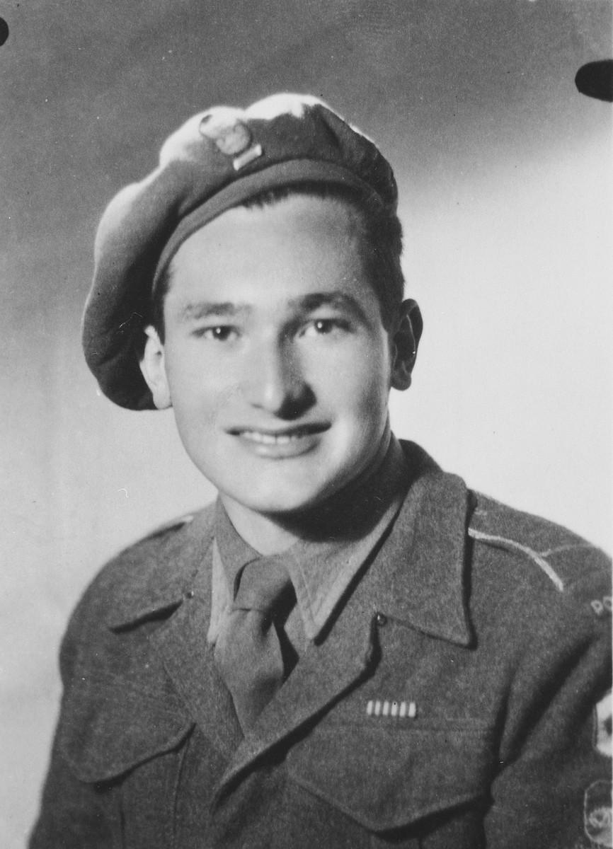 Studio portrait of a Jewish soldier in the Anders Army wearing a ribbon for the Cross of Monte Cassino.  Pictured is Lance Corporal Julian Bussgang.