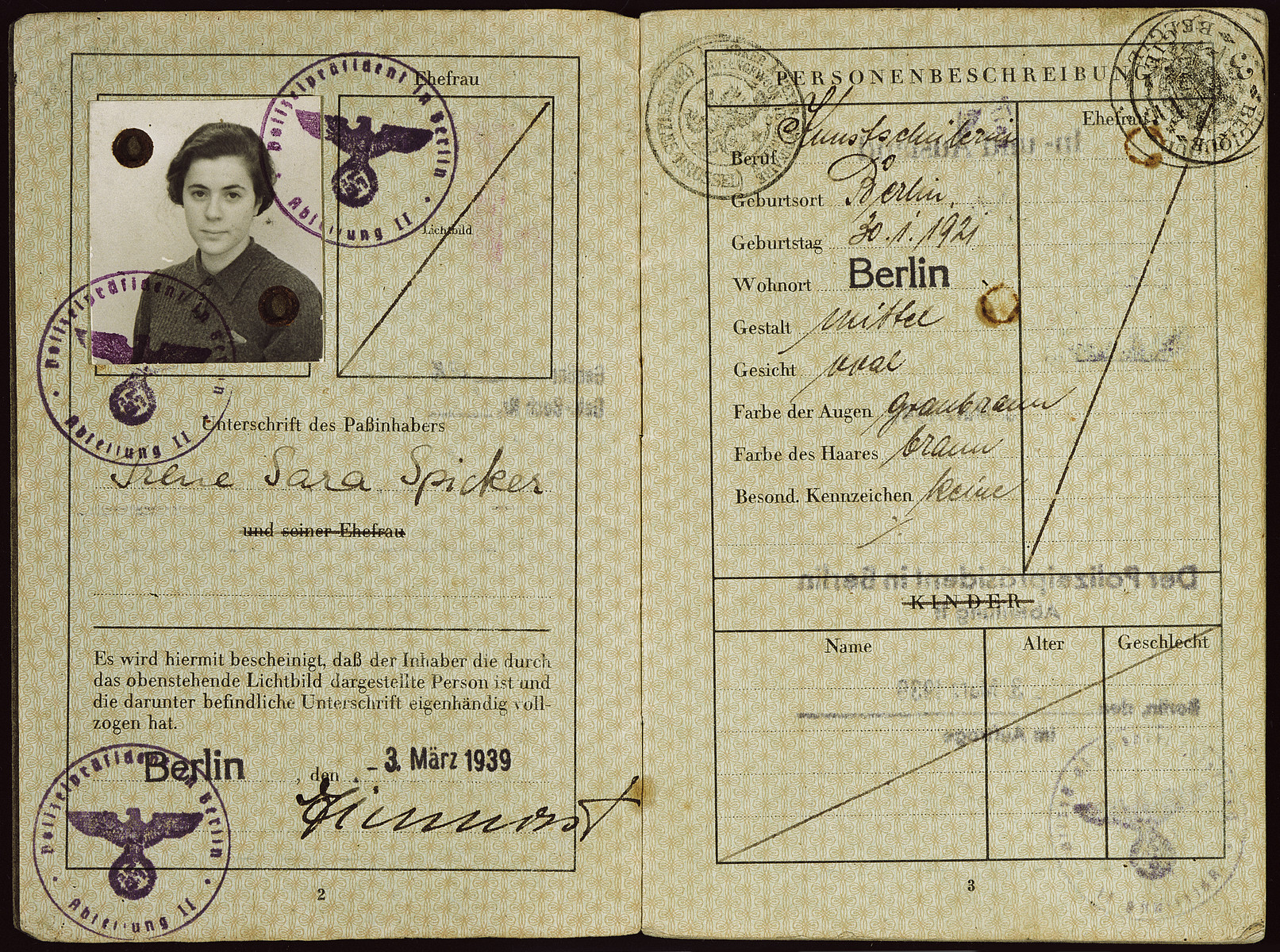 "Passport issued to Irene Spicker in March 1939 stamped with the Nazi eagle and displaying the imposed middle name of ""Sara""."