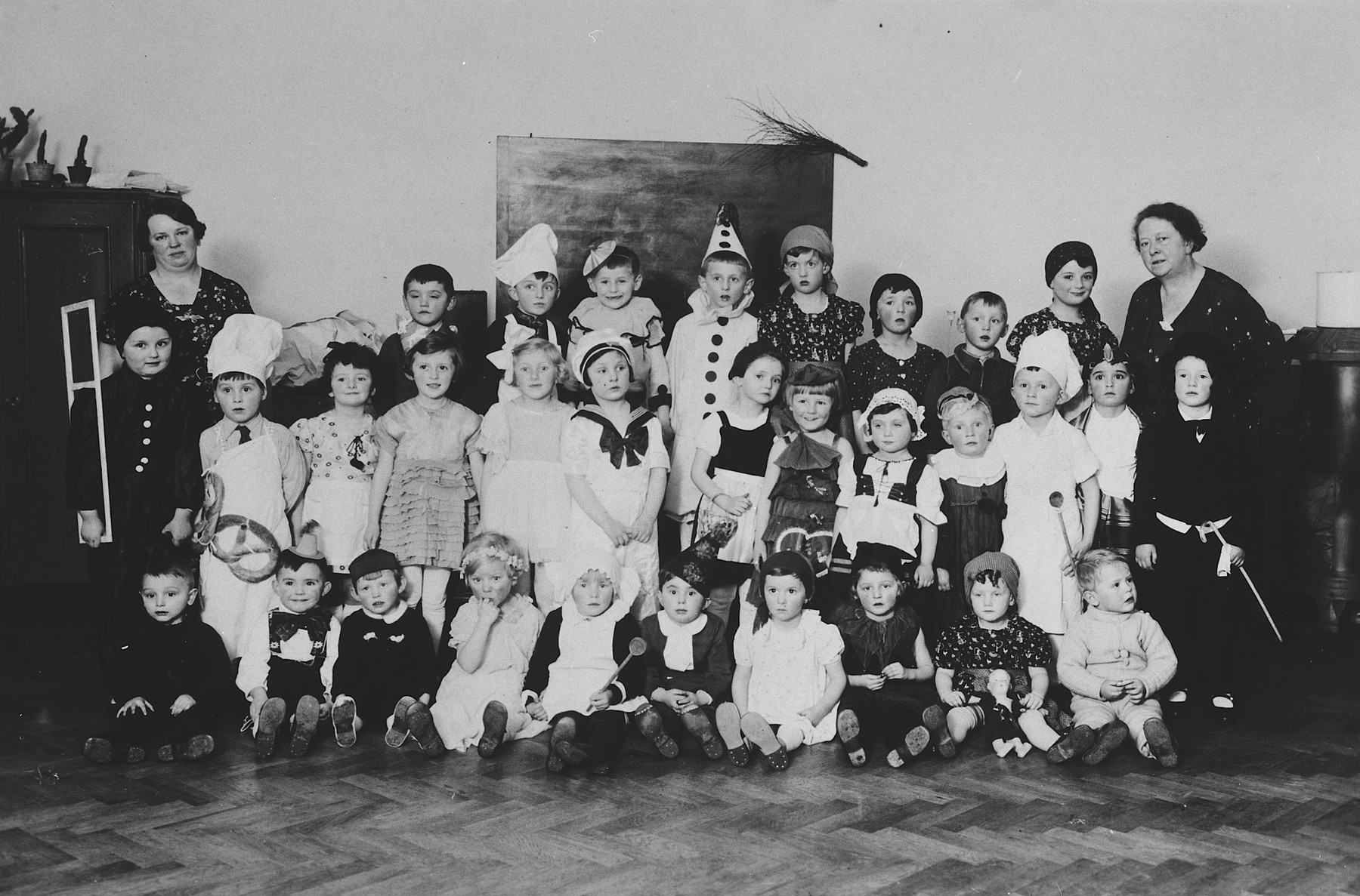 Children in a Czech kindergarten pose for a group portrait in costumes.