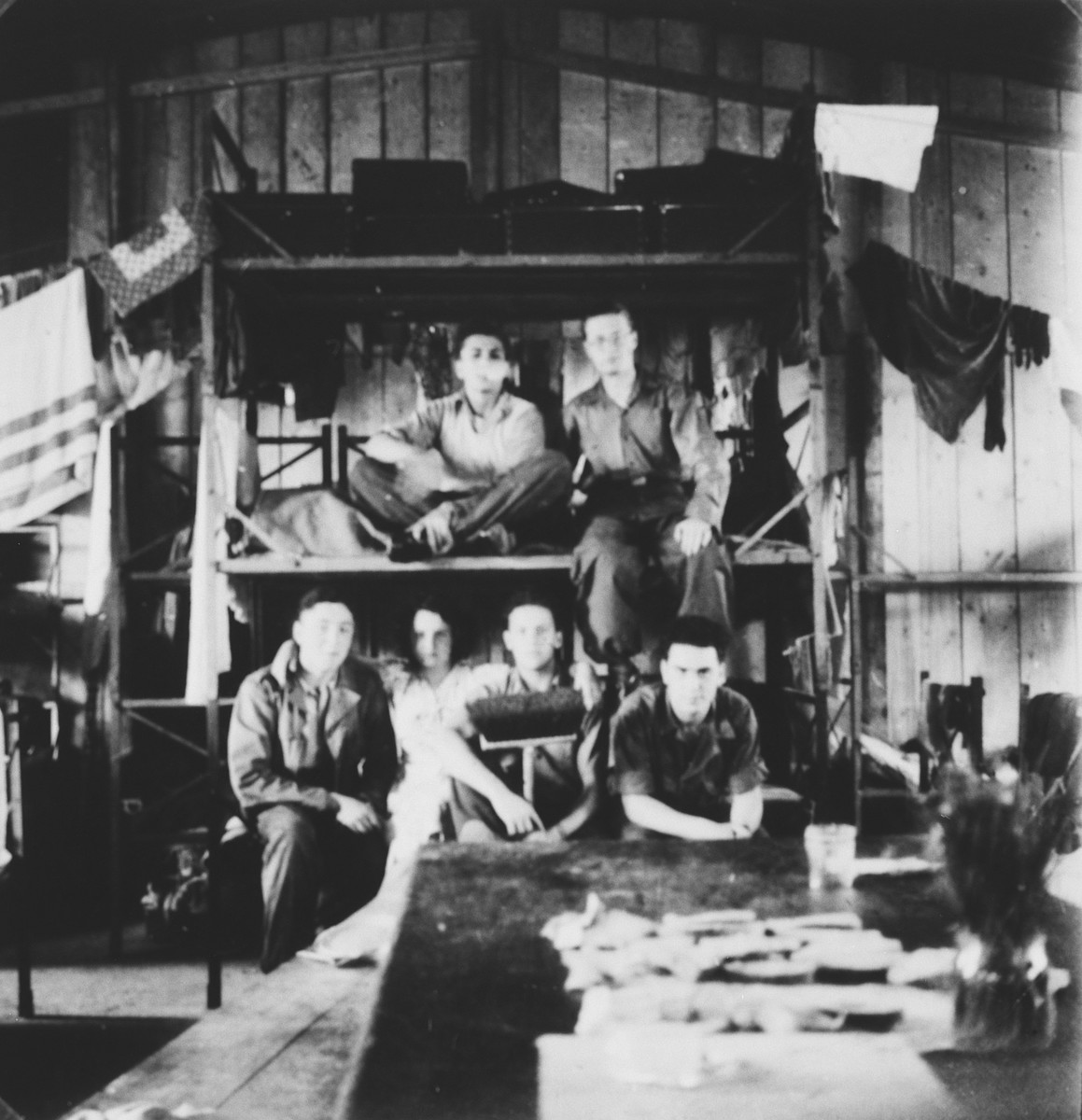 Jewish youth pose on bunk beds in a shelter where they are staying while on route to Israel.  Among those pictured is Ivan Pal.