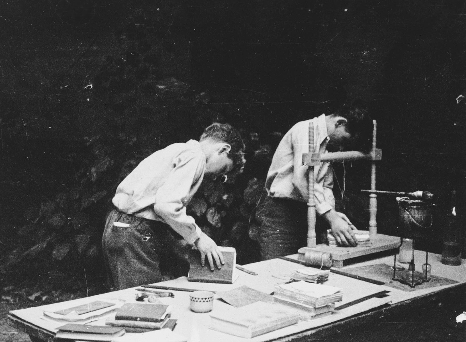Two boys practice book-binding in La Forge, an OSE children's home in Fontenay-aux-Roses.  Pictured in front is Andre Limot.