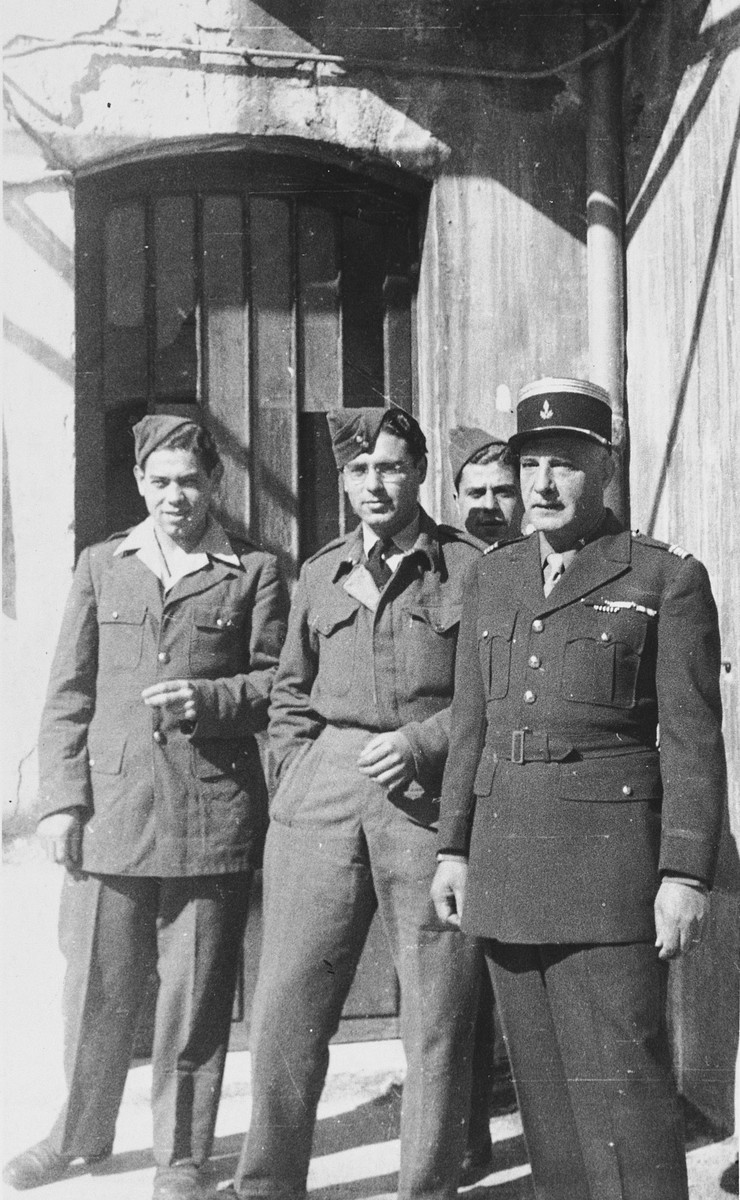 "Jewish soldiers from France, North Africa, Britain and the United States pose together outside the synagogue in Marseilles where they have come for Passover services.  The original caption reads, ""North African, British and French were all at services.  Common purpose, common G-d!  American soldiers were in the greatest majority."""