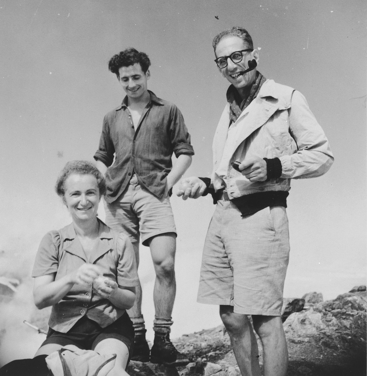 Three Jewish refugees go mountain climbing in the Swiss hills.  Amont those pictured are the photographer, Walter Limot (far right) and his wife Ines.
