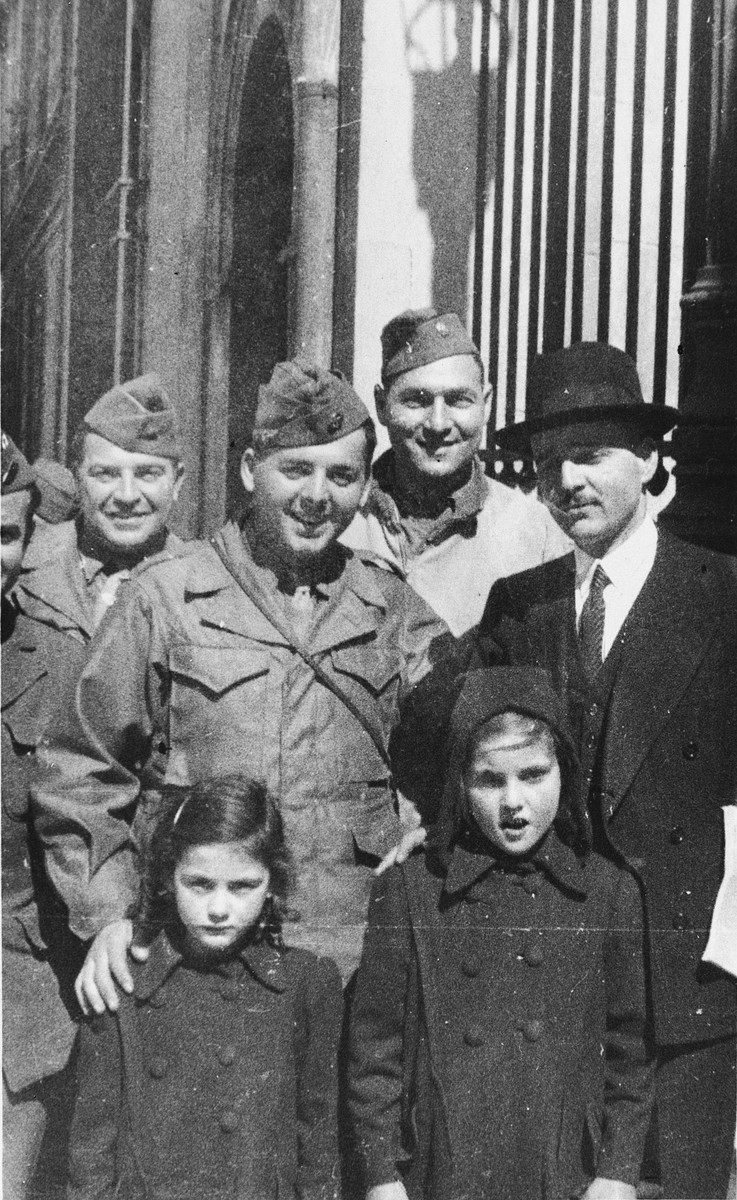 The rabbi of Marseilles poses with his daughters and Jewish-American servicemen outside the synagogue.