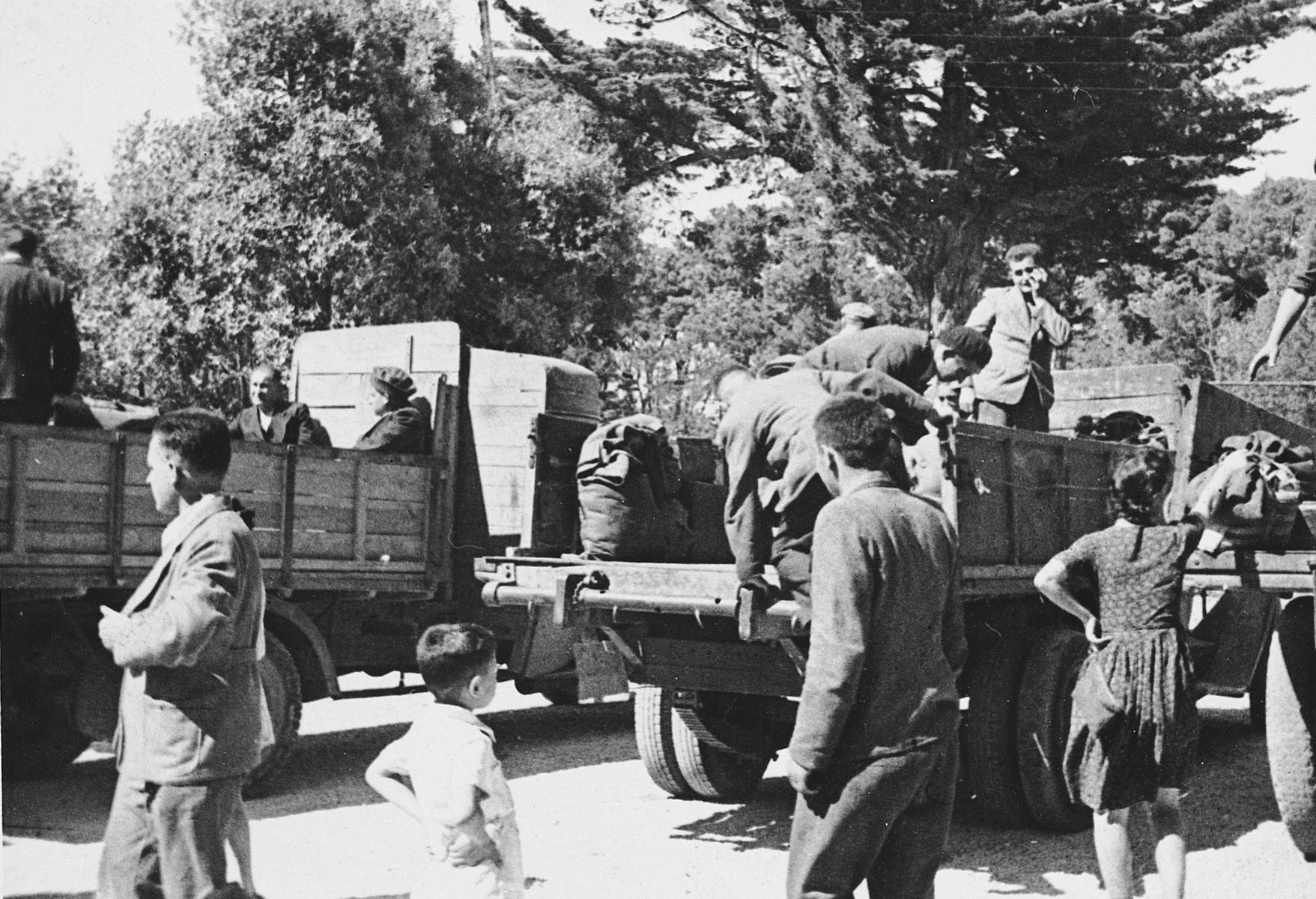 "Survivors from Buchenwald arrive by truck in Marseilles prior to departing for Palestine [probably on the Mataroa].  The original caption reads, ""Some Buchenwald refugees moving in -- June 1945."""