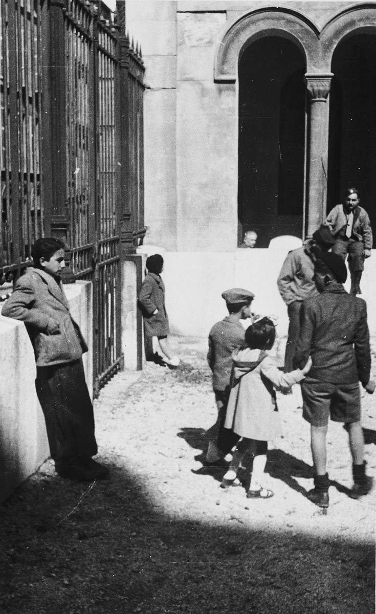 Jewish children enter the synagogue in Marseilles where an American Jewish chaplain is organizing Passover religious services.