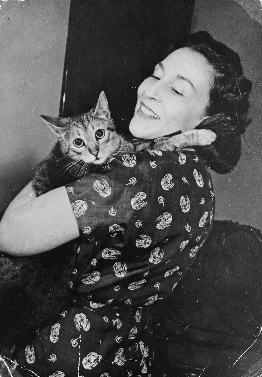 Portrait of a Hungarian actress, who had lent assistance to a Jewish family, during the war holds her cat.  Pictured is Margit Markay.  She kept the valuables of the Pal family safe for them until after the war.  She also brought them food while they were in the ghetto.