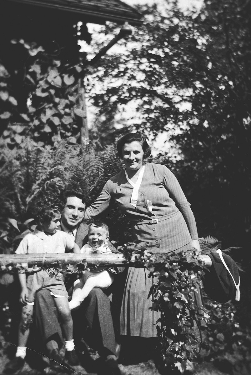 A Czech-Jewish couple poses in their garden with their two young sons.  Pictured are Hermann, Sabina, Hans and Alexandre Fischler.