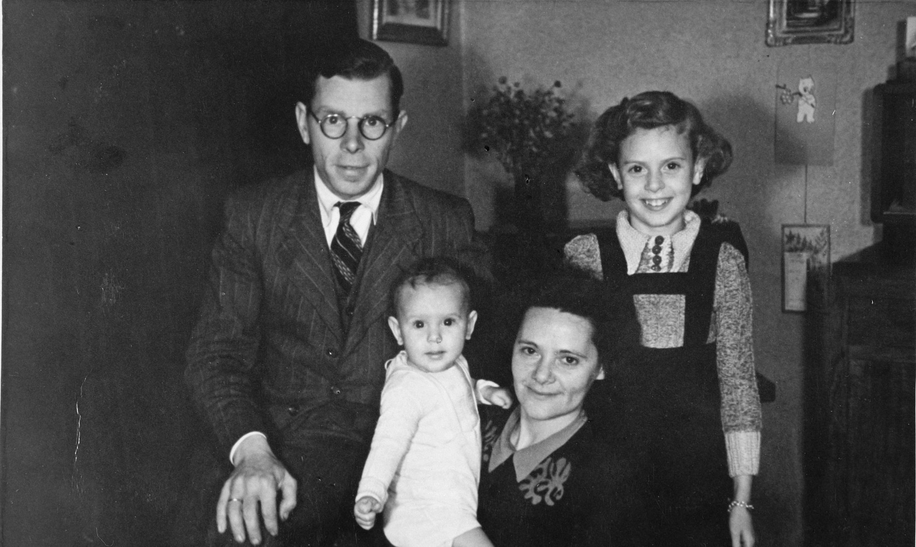 Portrait of a half-Jewish family shortly after liberation.  Pictured are Jan and Maria Braat holding their new infant son, Rene, and their nine year old daughter Betty.