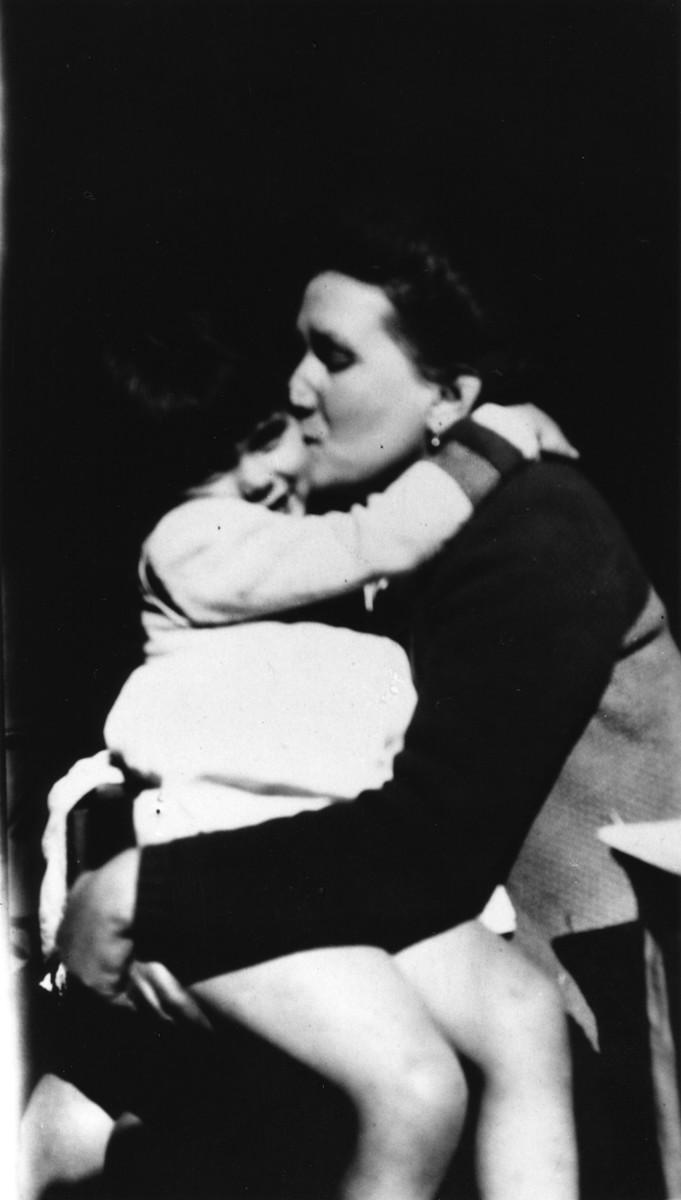 Marie Antoinette Pallarès hugs Diane Popowski.