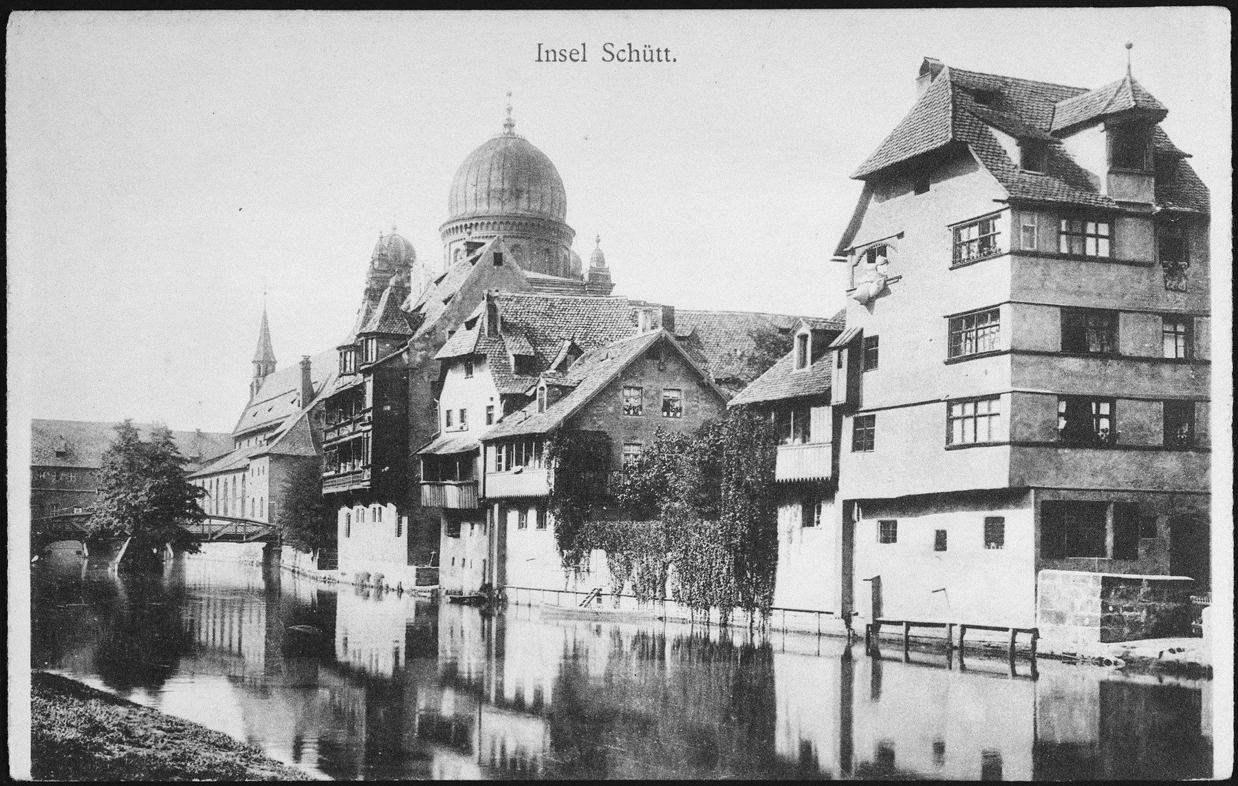 Picture postcard showing a view of the dome of synagogue on the Insel Schuett in the Pegnitz River in  Nuremberg, Germany.