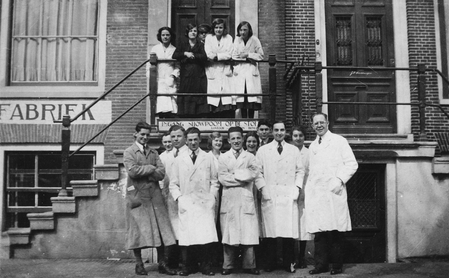 Workers pose outside the store where they work in Amsterdam.  Pictured on the top tow left is Maria Bertha Mooleman.