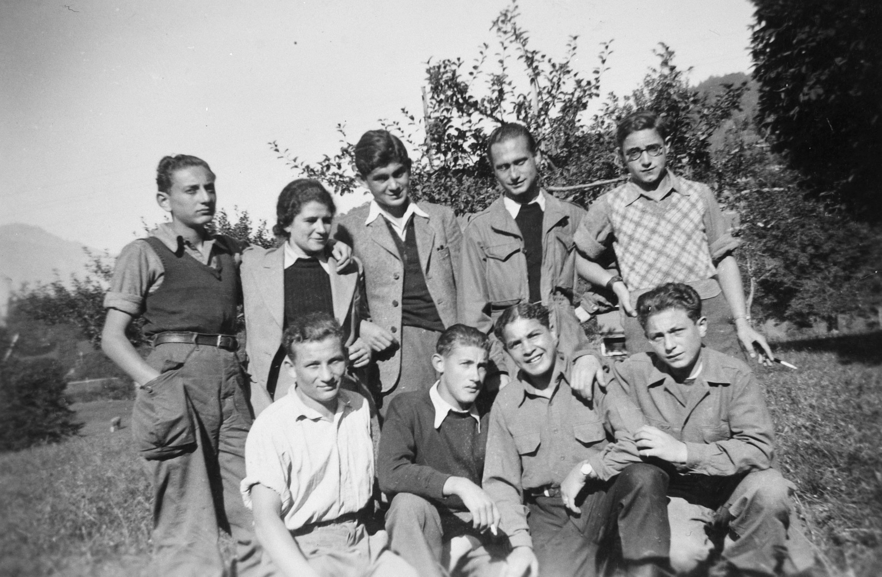 Group portrait of Jewish youth in a children's home in Switzerland.  Moniek Szmulewicz is pictured in the front row, second from the right.  Michael Rosenberg is standing, second row middle.
