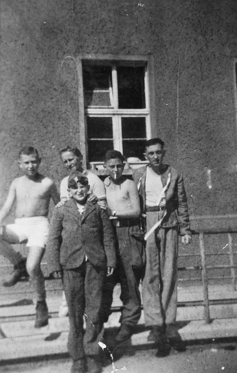 Five young survivors pose in front of a barracks in the Buchenwald concentration camp about a month after liberation.