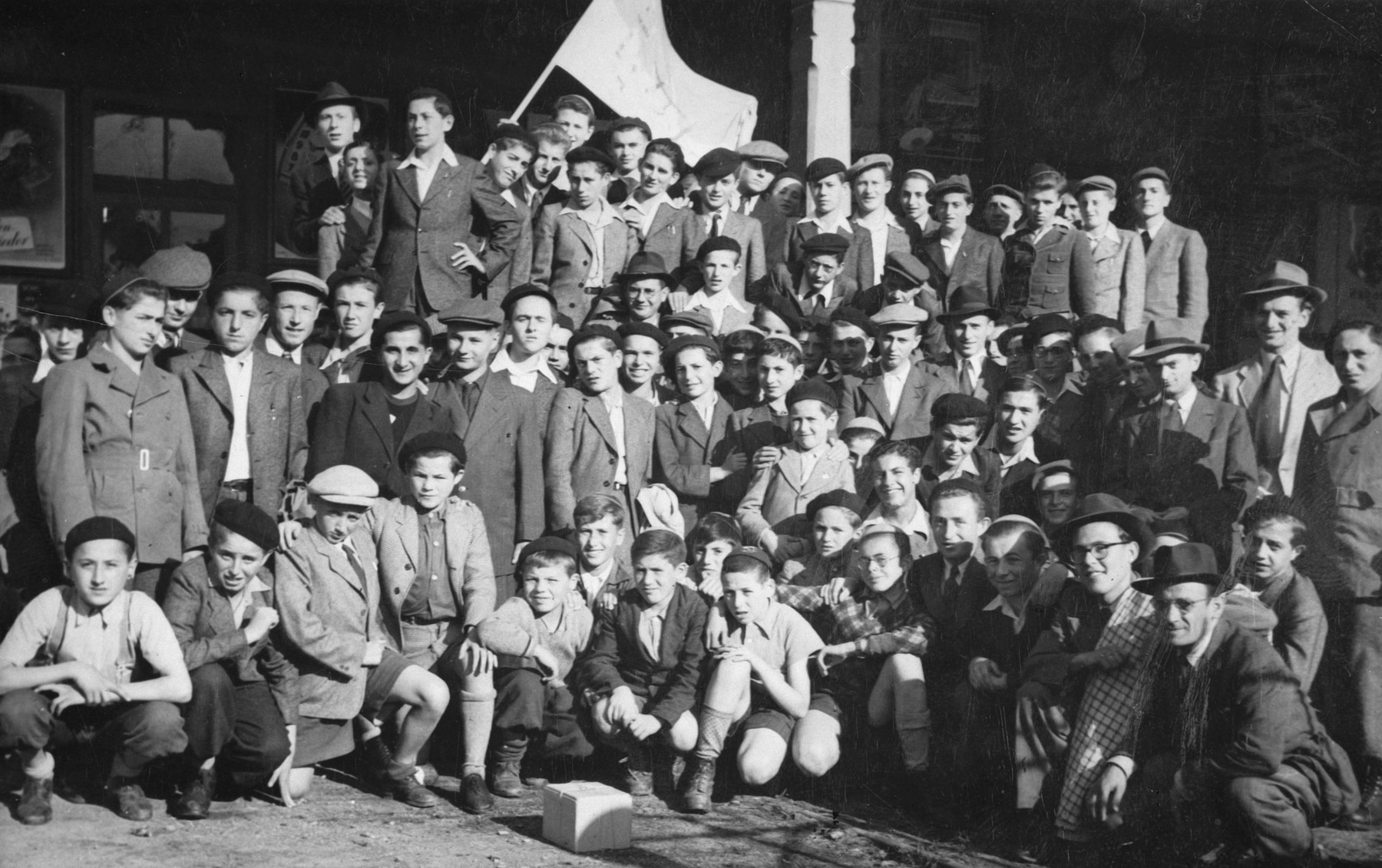 Group portrait of Jewish youth and members of the religious Zionist youth movement, Poale Agudat Yisrael, in a children's home in Switzerland.