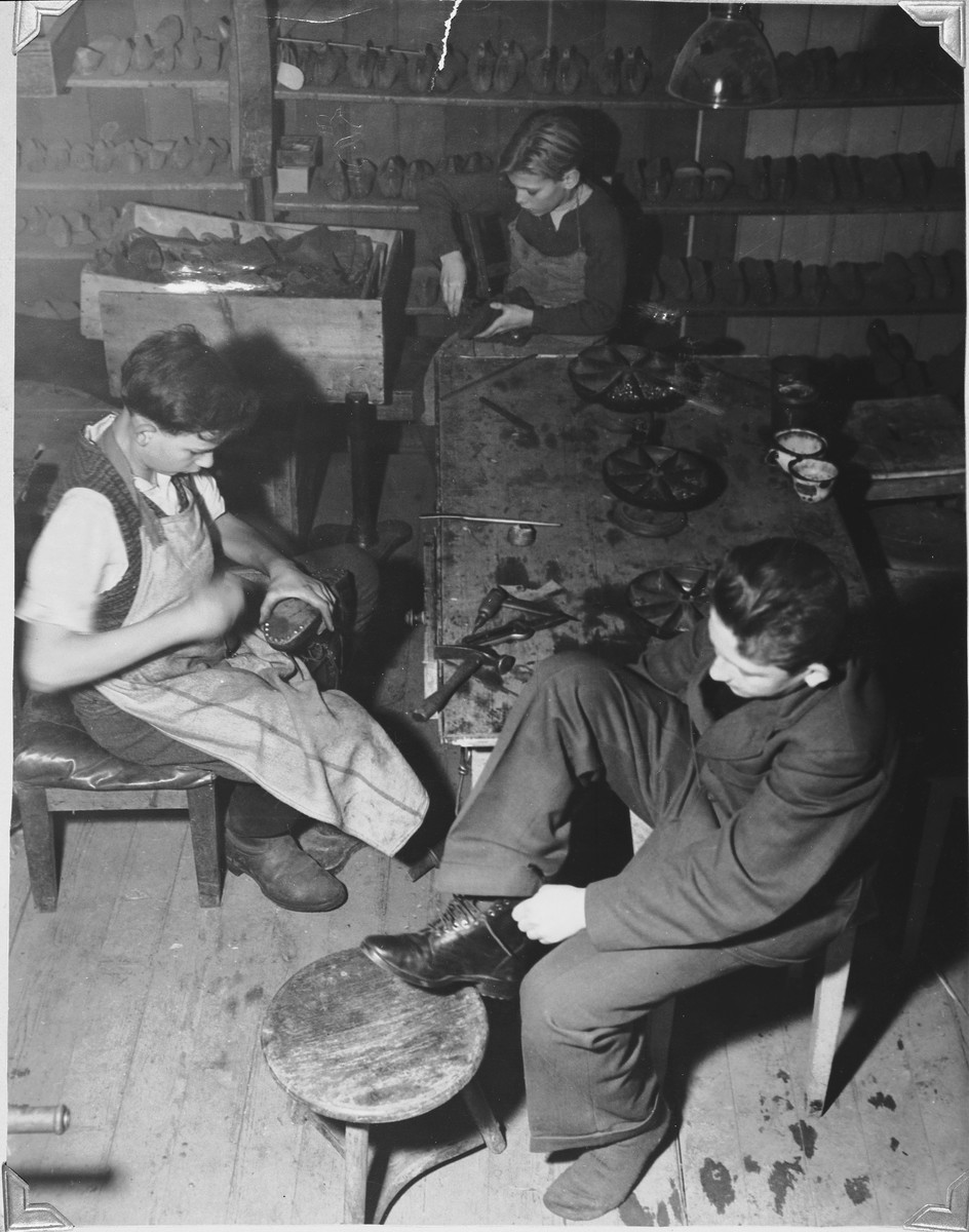Jewish youth learn shoemaking in a workshop in either the Foehrenwald or Windsheim displaced persons' camp.