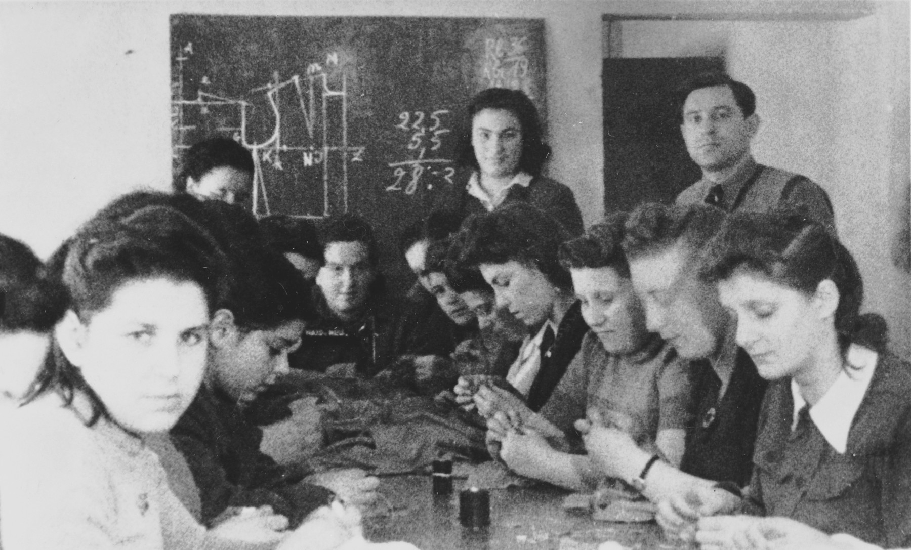 Women study dressmaking in a vocational workshop in either the Foehrenwald or Windsheim displaced persons' camp.