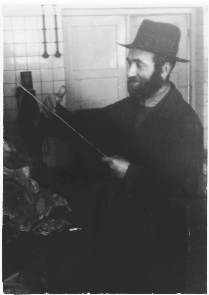 Close-up portrait of a kosher butcher in what [probably is the Windsheim] displaced persons' camp.