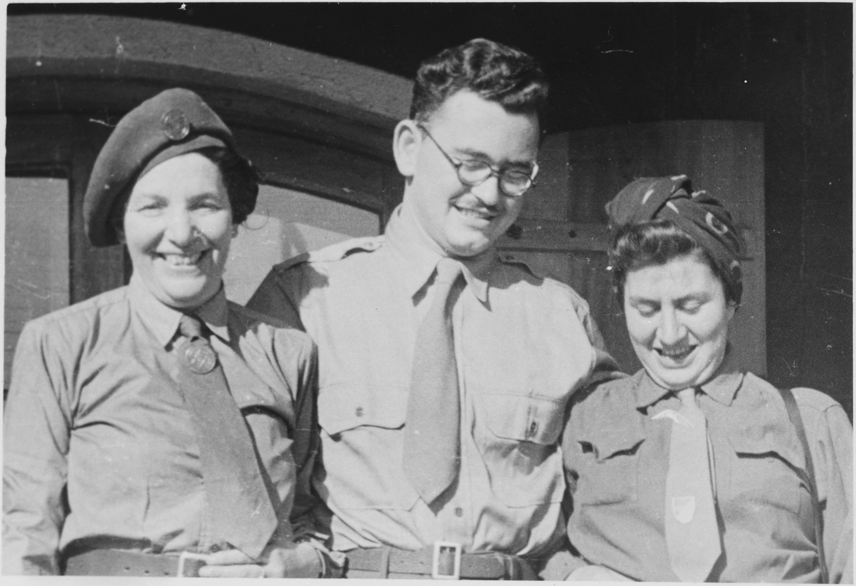 Close up portrait of three UNRRA workers in the Windsheim displaced persons' camp.  Stanley Abrmowitz is pictured in the center.