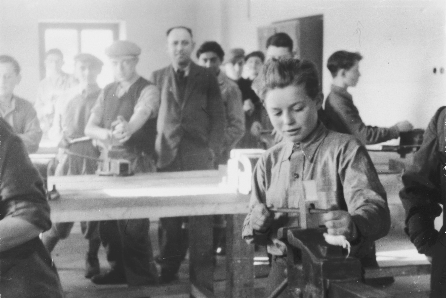 Young men study locksmithing in a vocational workshop in either the Foehrenwald or Windsheim displaced persons' camp.
