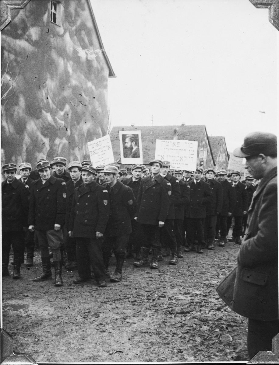 Jewish policmen carrying a portrait of Theodor Herzl march in a Zionist demonstration in the Windsheim displaced persons' camp.