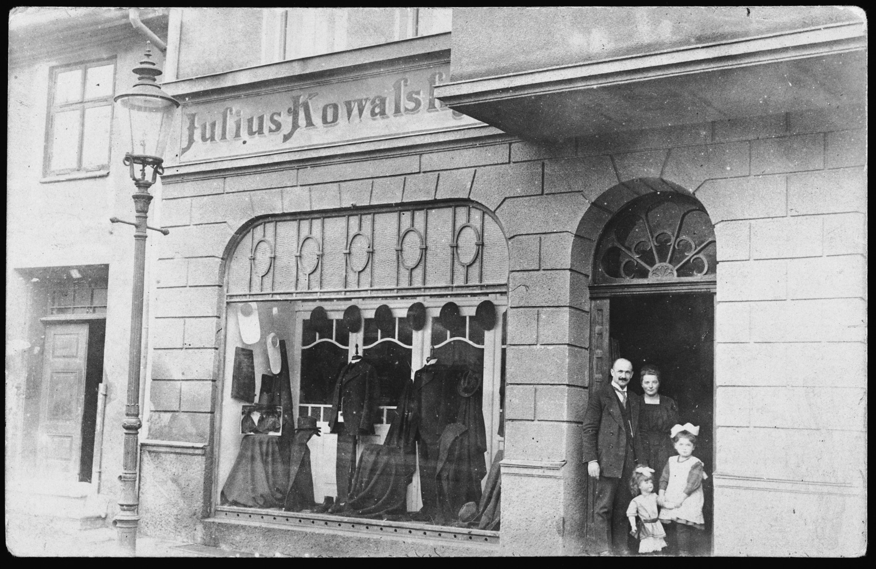 A German family poses outside its clothing store in East Prussia.   Pictured are Julius Kowalsky, his wife and daughter Gertrude (mother of the donor).