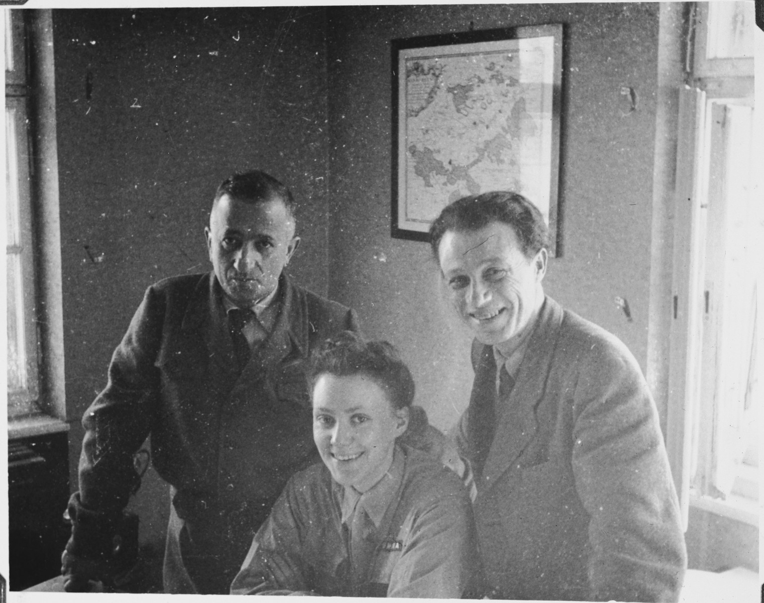 The Jewish administrator of the Windsheim displaced persons' camp (right) meets with UNRRA worker, Marion Pritchard an danother man.