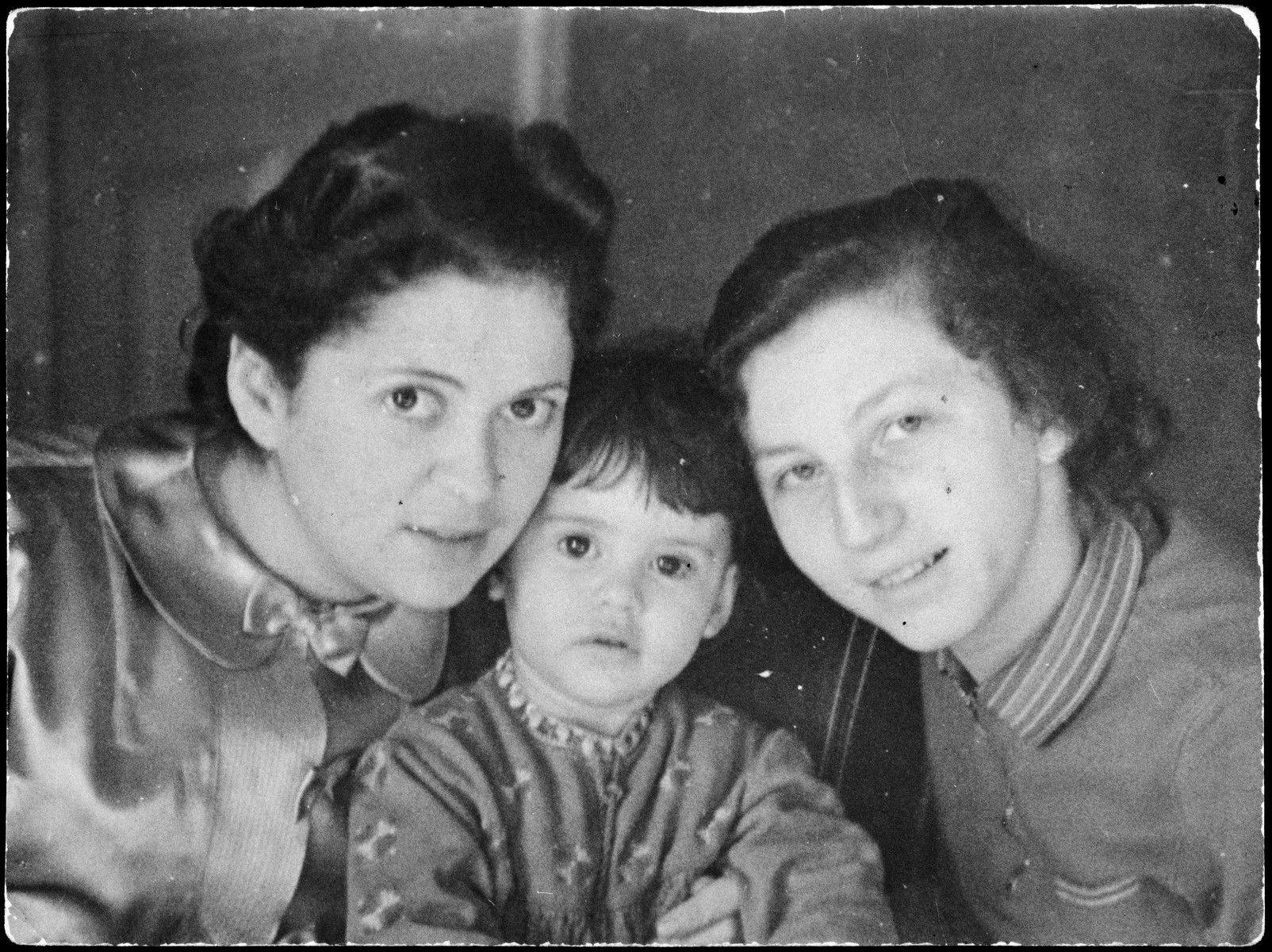 Close-up portrait of two German Jewish women and a young baby girl.  Pictured from left to right are Gertrude Rubenstein, her daughter Ruth Marion and the nanny, also Ruth who perished during the Holocaust