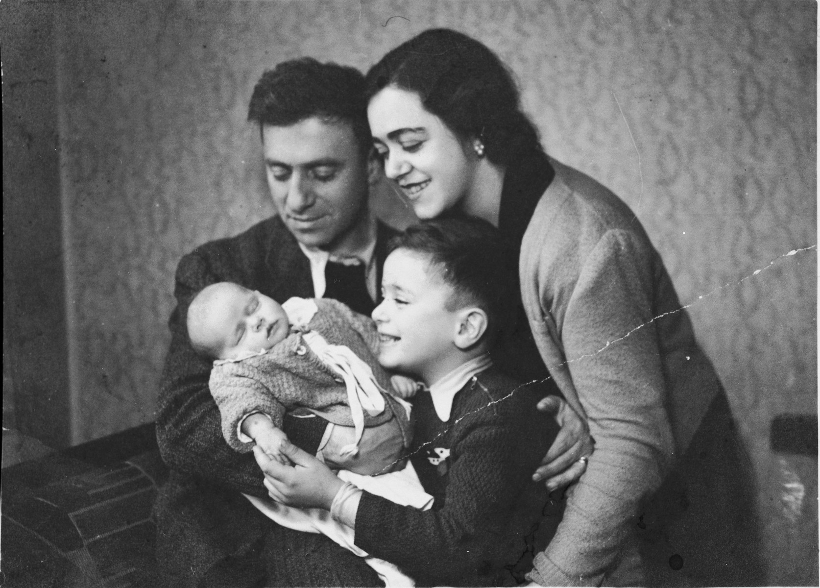 Gabriel and Victoria Avramoff pose with their son Misha and new born daughter Adela.