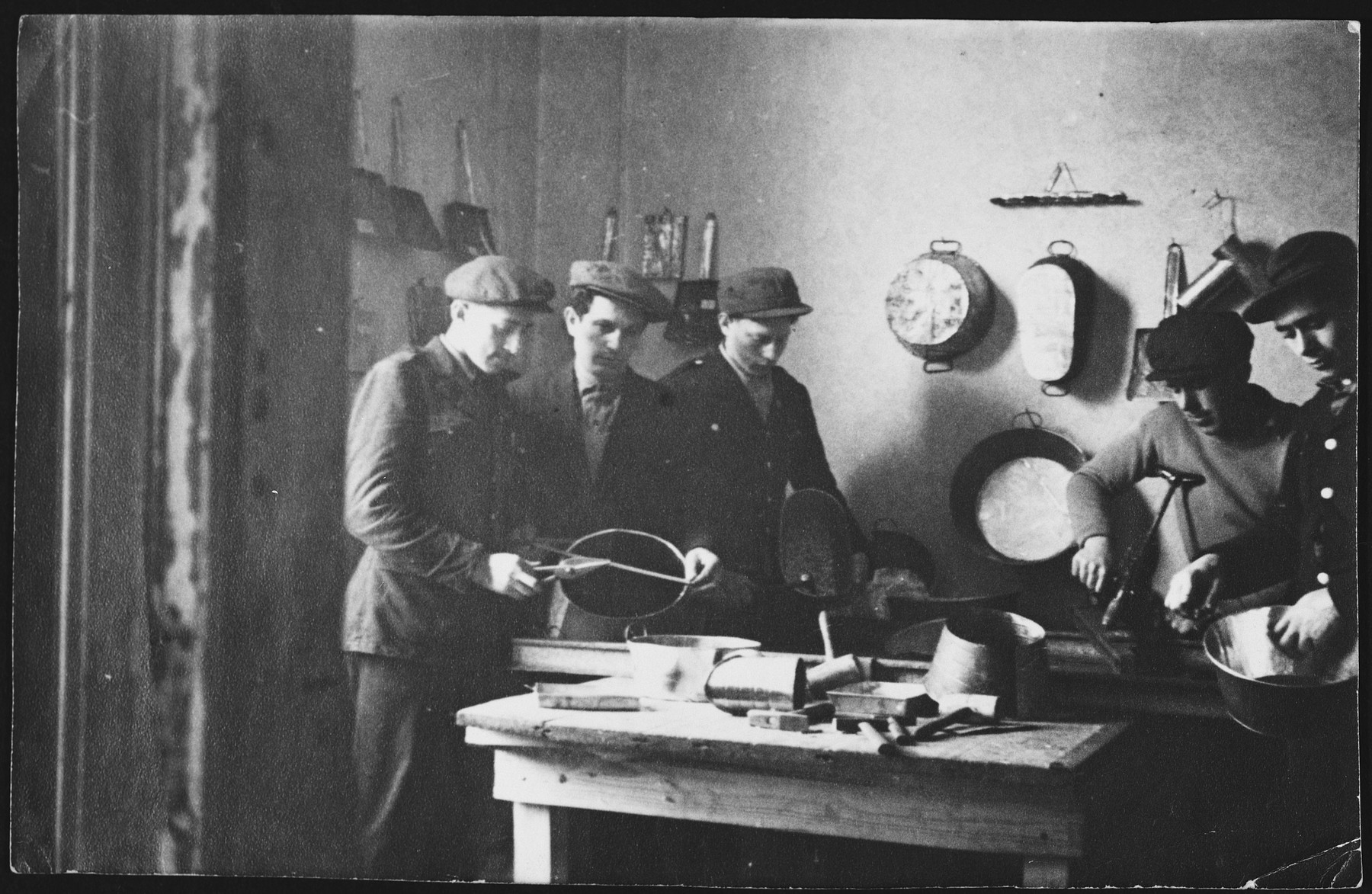 Jewish men work in a metal workshop in the Windsheim displaced persons' camp.