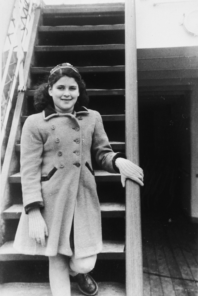 Close-up portrait of a Jewish child who had survived the Holocaust in hiding en route to the United States.  Pictured is Ruth Marion Rubenstein.