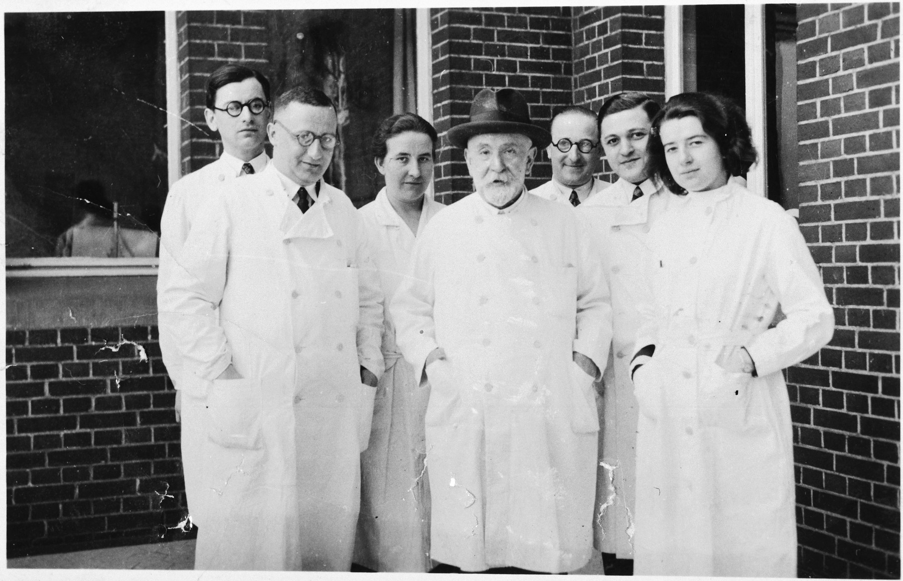 Group portrait of the staff of the Jewish hospital in Berlin.  Dr. Heinz Rubenstein is pictured on the far left in the back row.