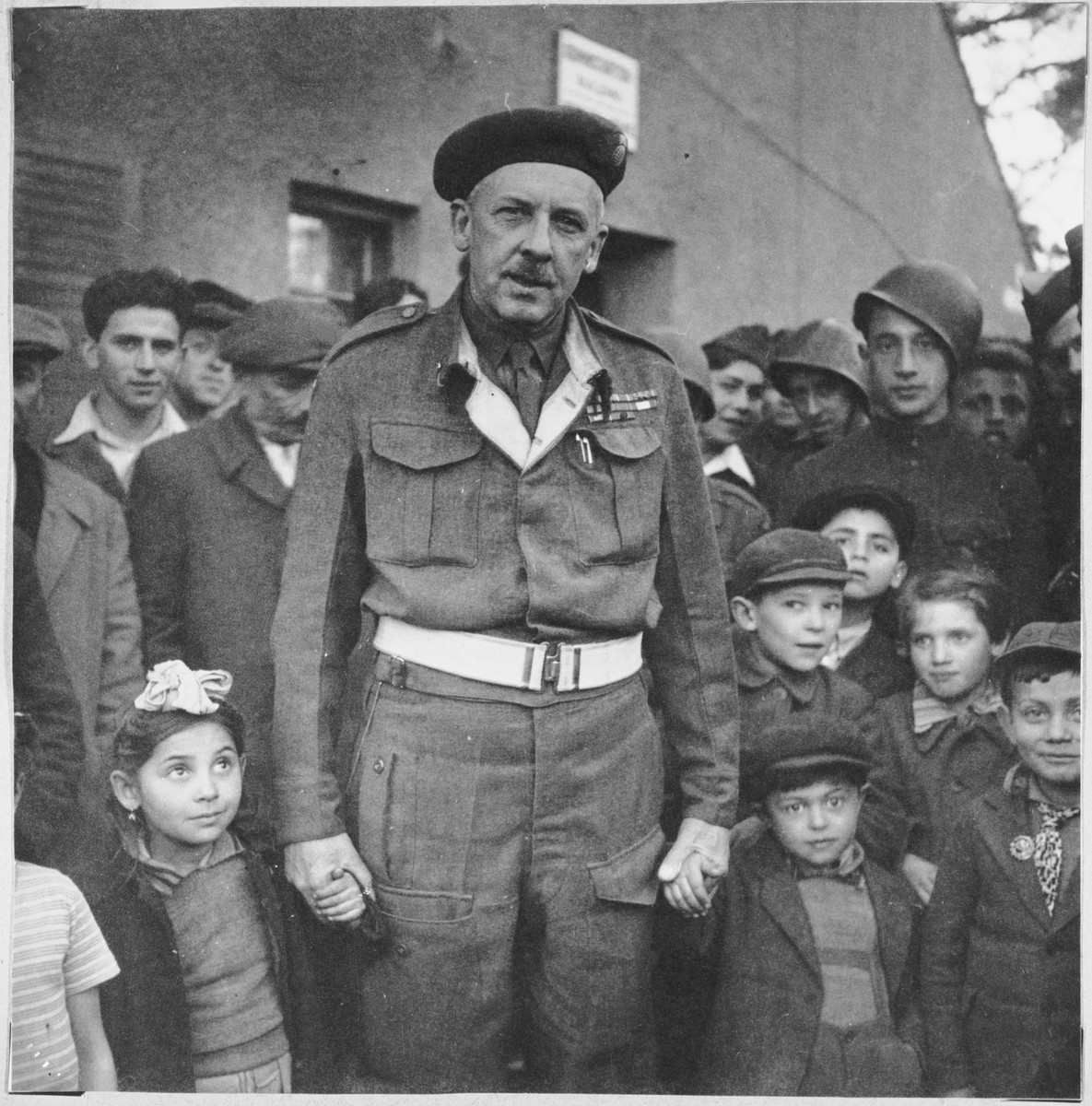 A British officer meets with children and other residents of the Foehrenwald displaced persons' camp.