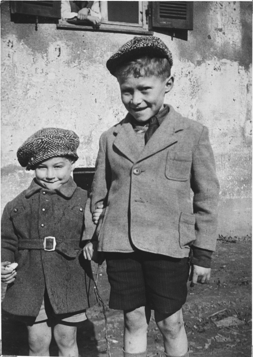 Close up portrait of a two Jewish boys holding hands in the Windsheim displaced persons' camp.