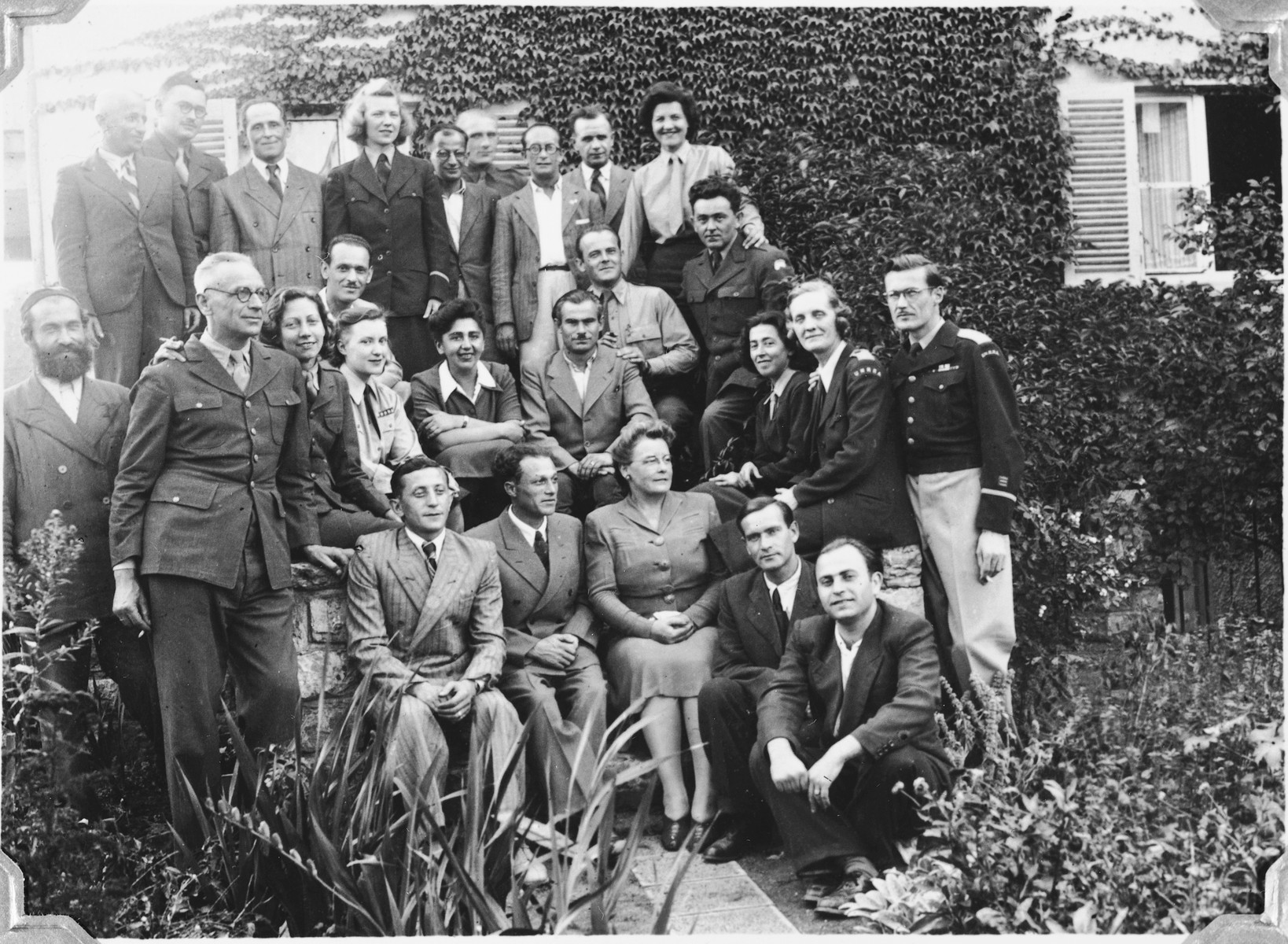 Group portrait of DPs and UNRRA workers in the Windsheim displaced persons' camp.  Pictured in second row on the far right is Tony Pritchard, director of the Windsheim camp and husband of the donor.