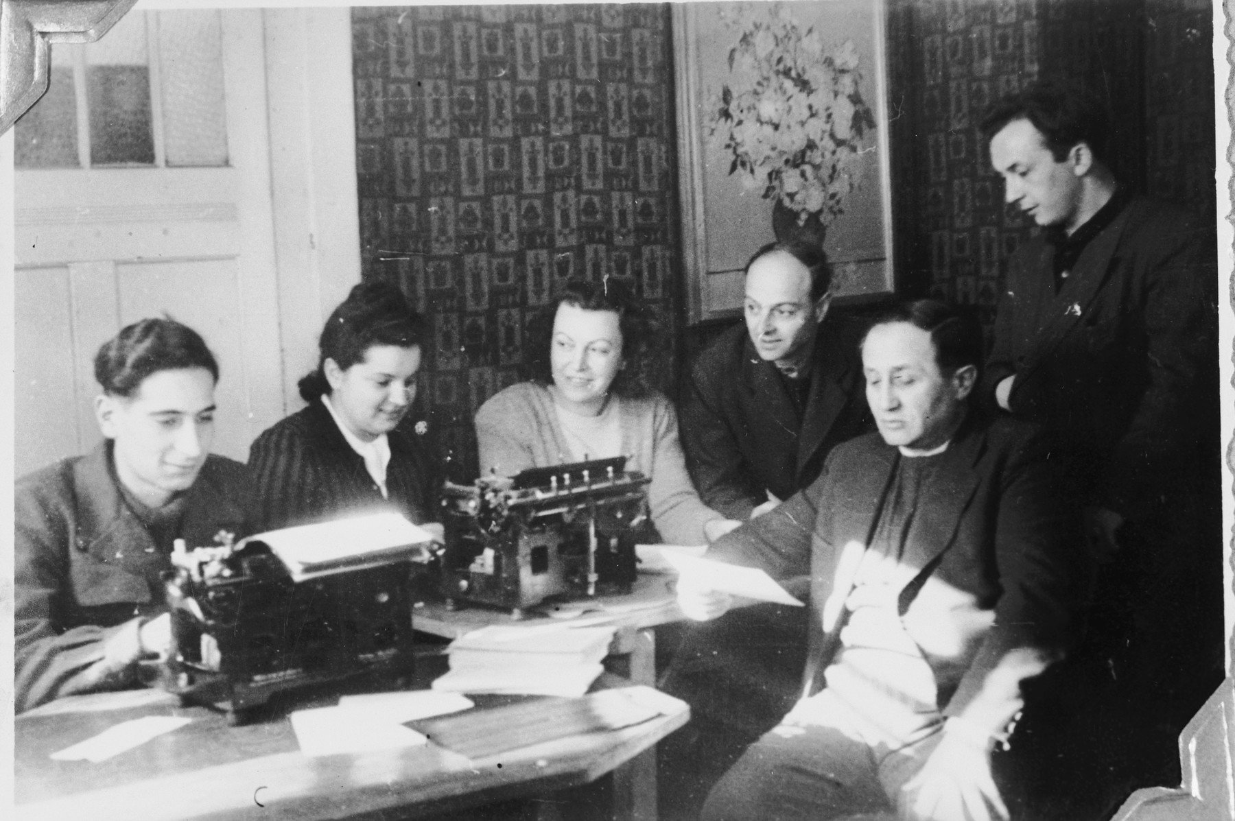 Jewish DPs work inside the office of the Windsheim displaced persons' camp.
