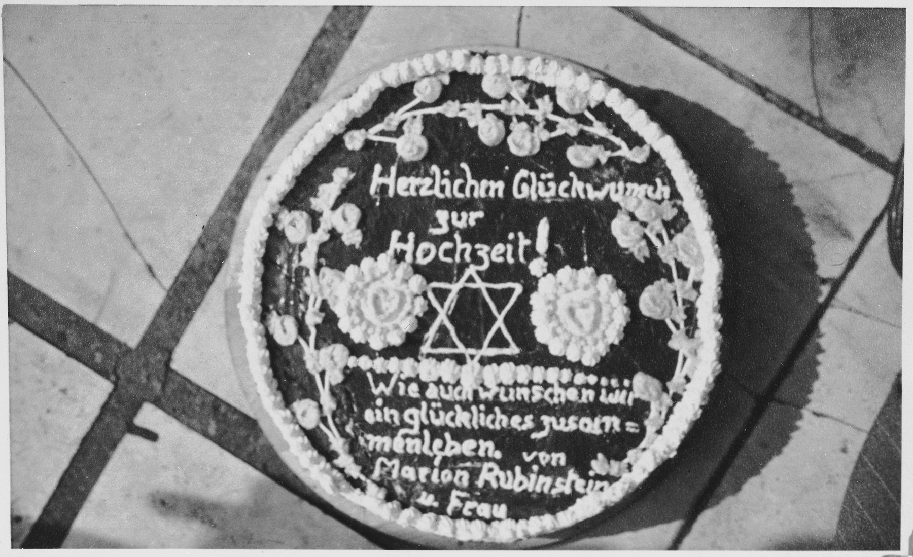 View of the cake prepared and decorated by residents of the Windsheim displaced persons' camp in celebration of the marriage of Tony and Marion Pritchard.