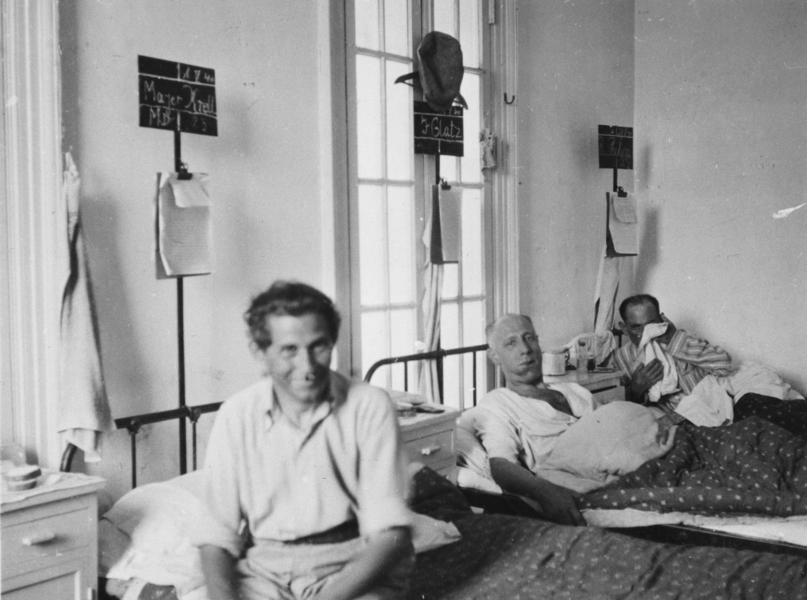 Patients sit and lie in their beds in the Shanghai Jewish hospital.
