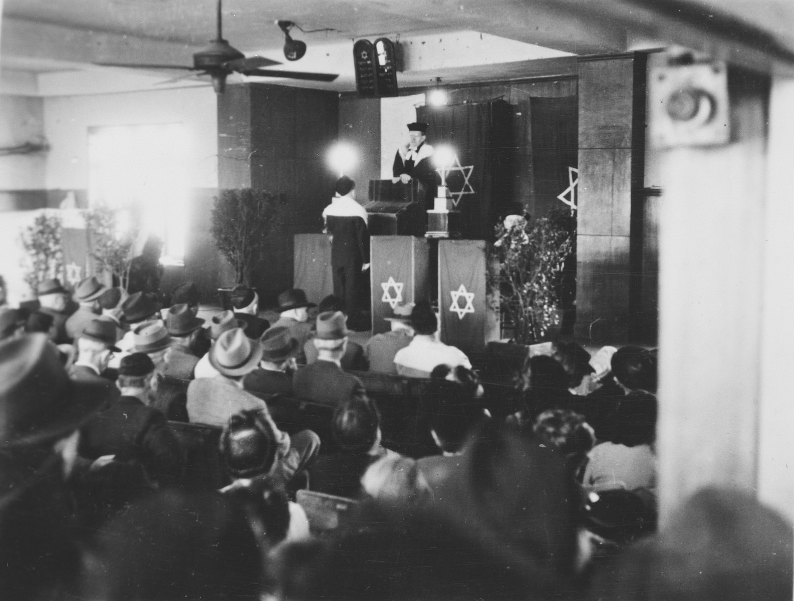 Jewish refugees gather for a religious service in Shanghai.