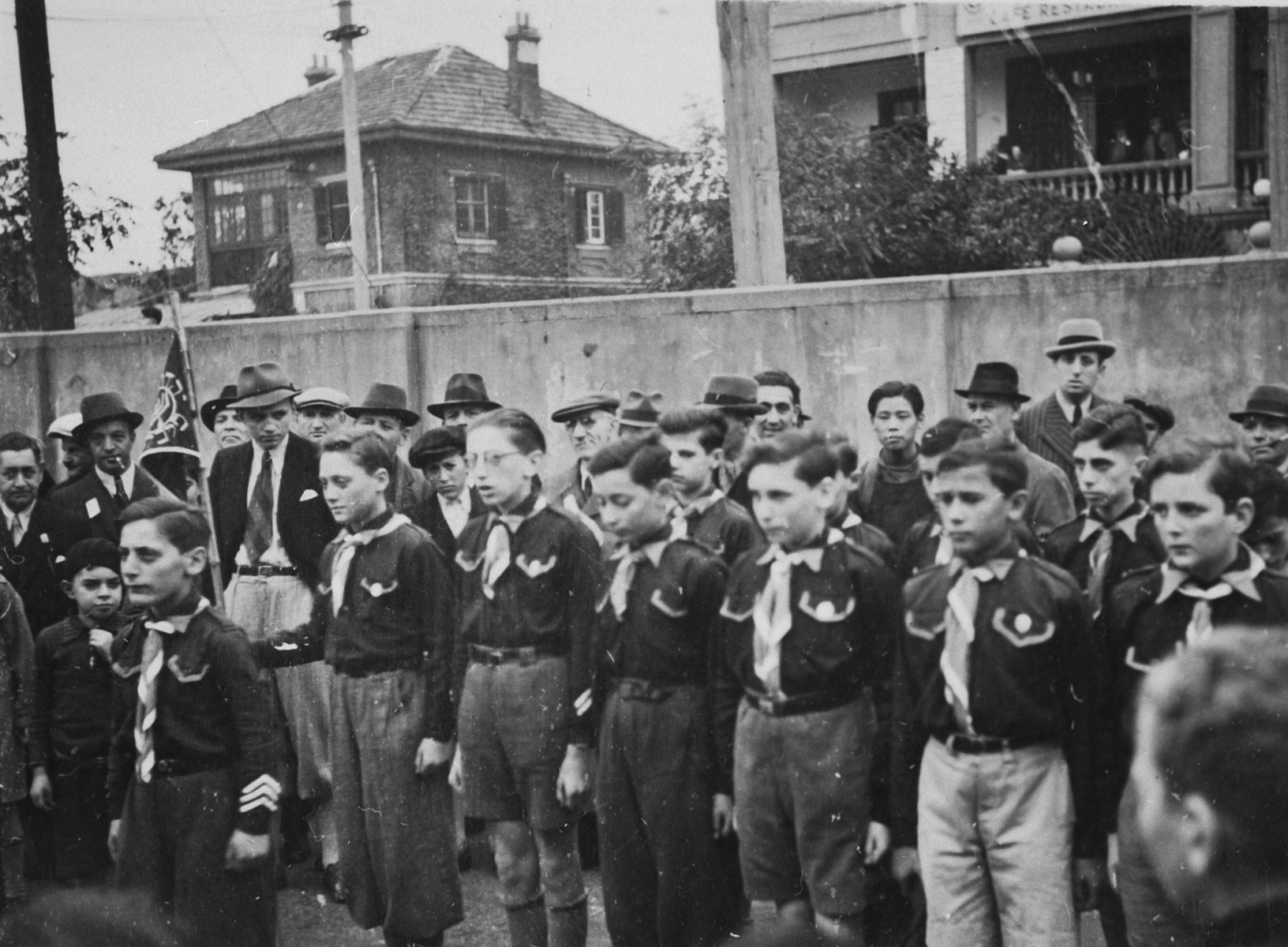 A troop of boy scouts stands at attention during a gathering in Shanghai.